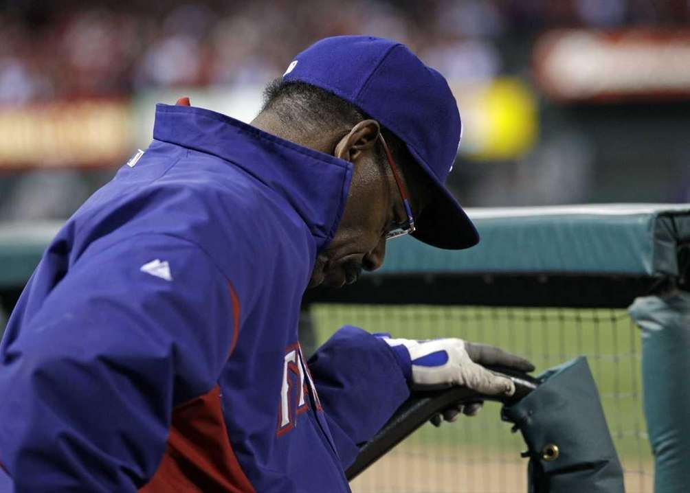 Texas Rangers manager Ron Washington puts his head