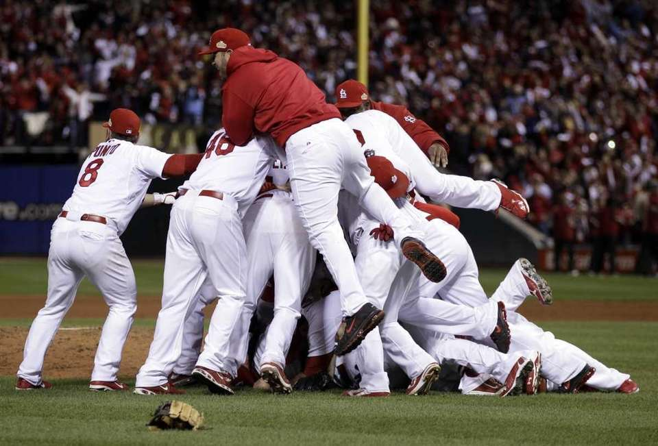 The St. Louis Cardinals celebrate after Texas Rangers'