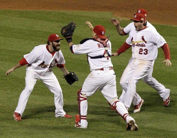 St. Louis Cardinals catcher Yadier Molina (4) leaps