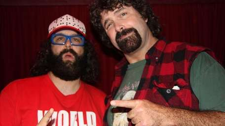 Mick Foley, right, hangs out with
