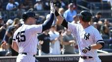New York Yankees' DJ LeMahieu is greeted by