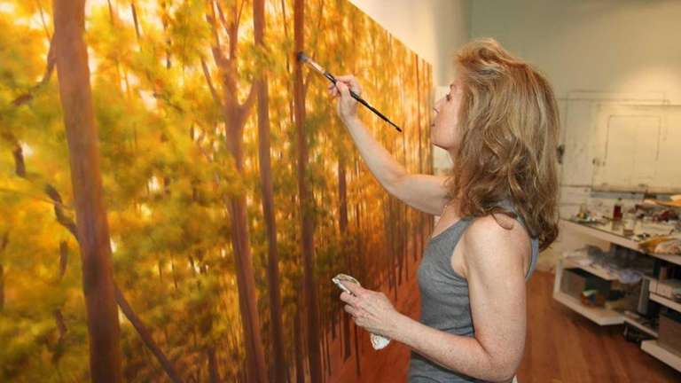 Artist April Gornik works in her studio in