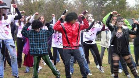 Zombie dancers run through a rehearsal of the