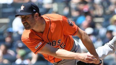 Houston Astros starting pitcher Justin Verlander follows through