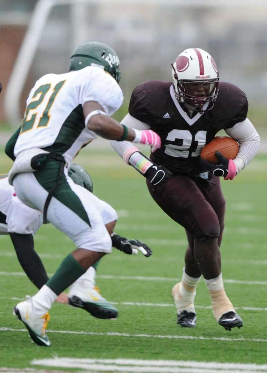 Bay Shore's Daquan Dunkley (21) trys to beat