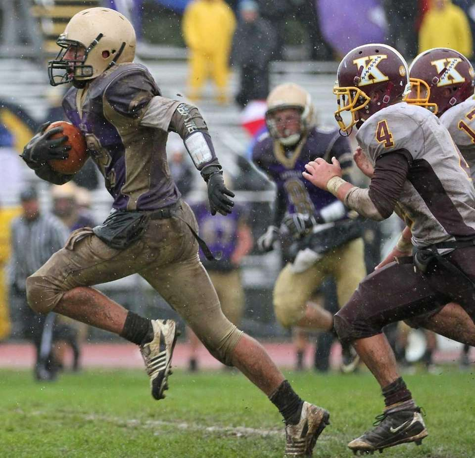 Sayville's quarterback breaks free and heads to the