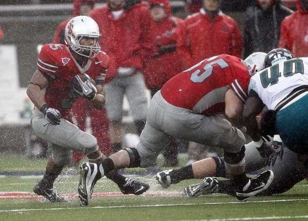 Stony Brook running back Miguel Maysonet (5) follows