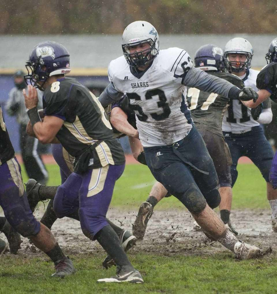 Eastport-South Manor's Sean Karl (63, right), prepares to