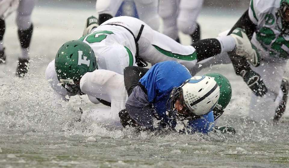 Oceanside's #44 goes face down into the ice.