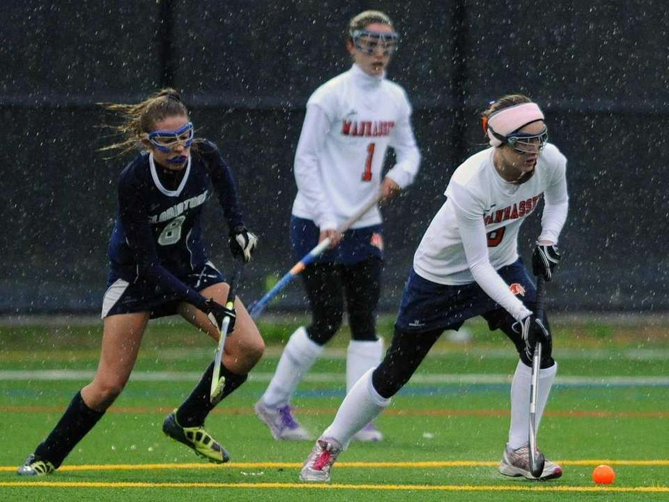 Manhasset High School #6 Erin Connors, right, gets
