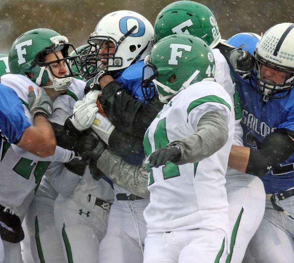 A group of Farmingdale defenders try to take