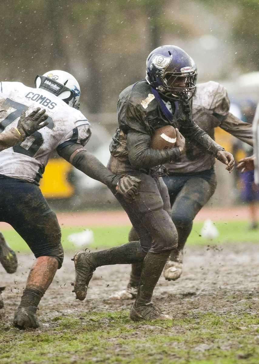 Islip's Thierry Byron (1, center with ball), finds