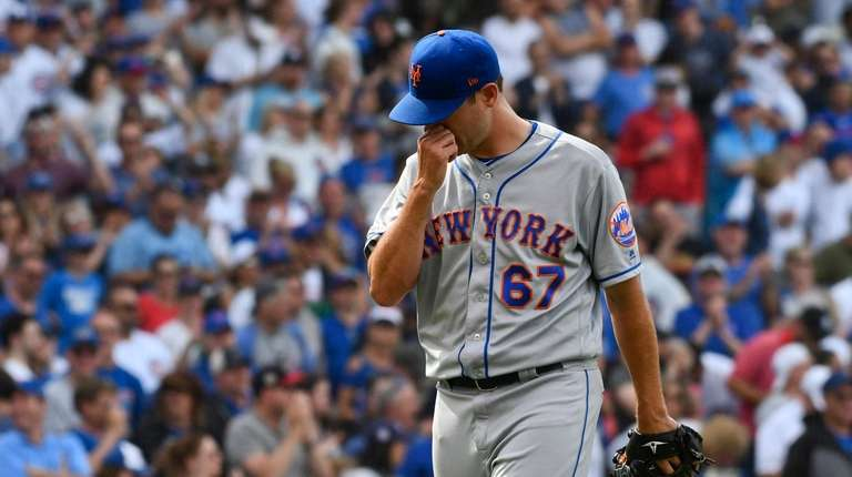 Mets relief pitcher Seth Lugo leaves after being