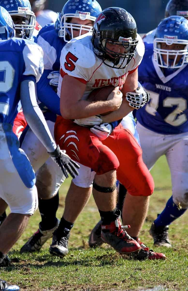 Newfield Ron Denig tries to break the tackle