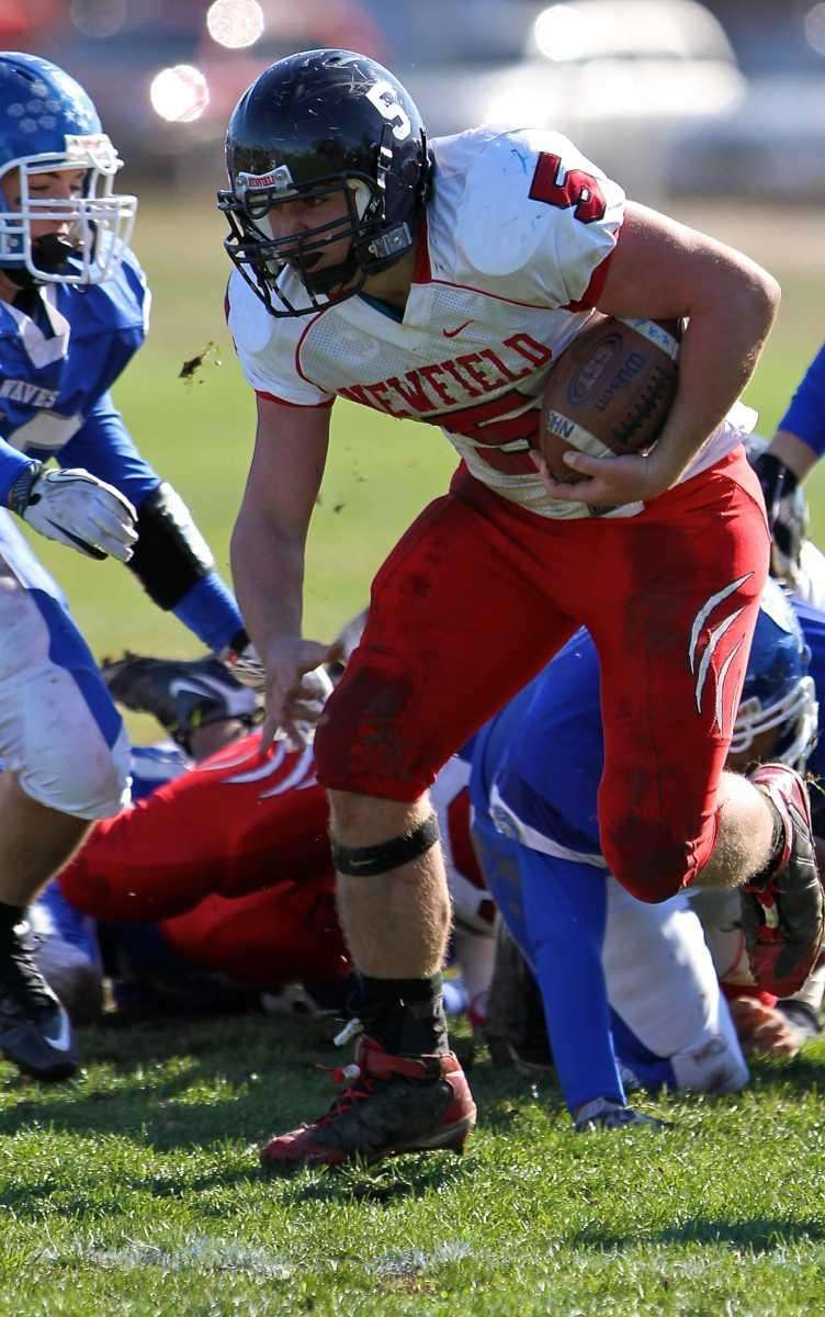 Newfield's Ron Denig bursts through the hole for