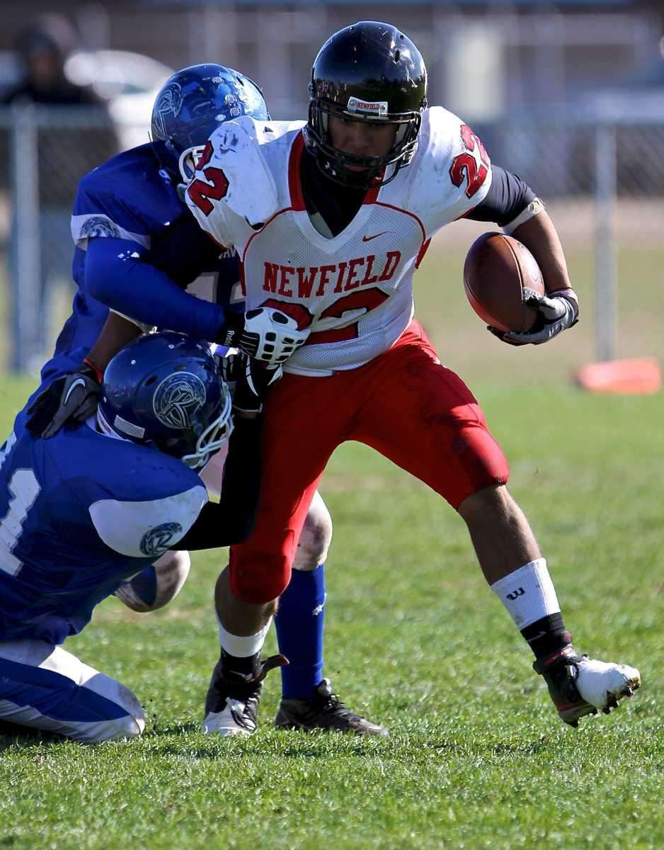 Newfield's Julian Santiago tries to break free of