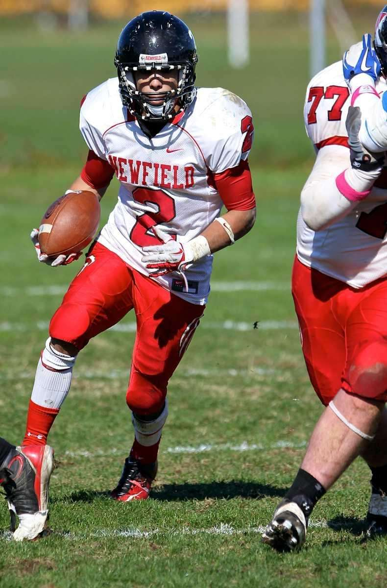 Newfield's Mike Silva holds the ball for quarterback