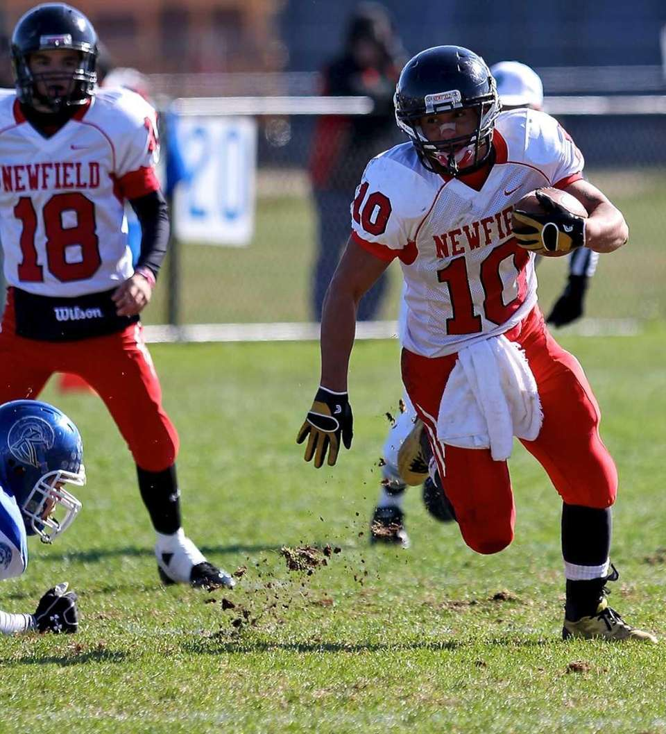 Newfield running Zach Powell takes the hand-off and