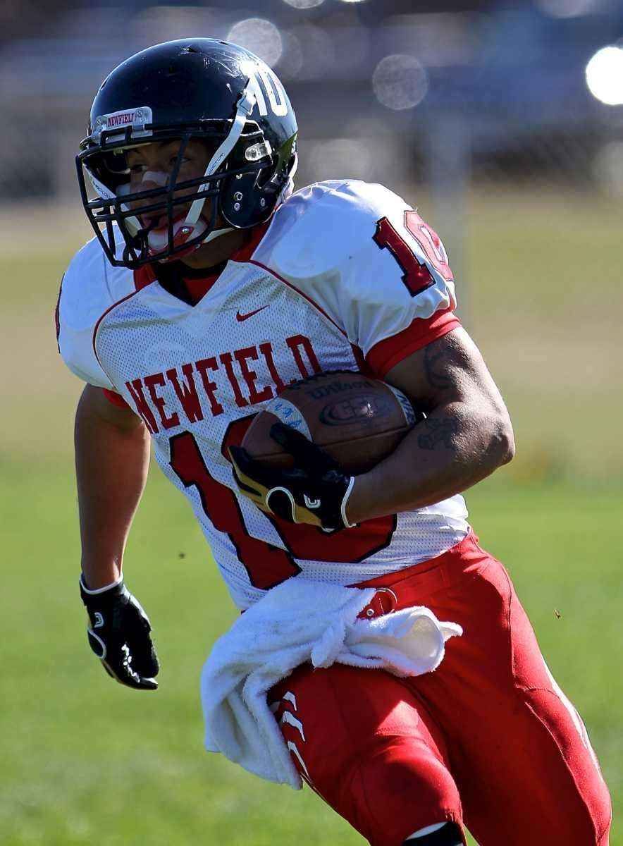 Newfield running back Zach Powell goes to the