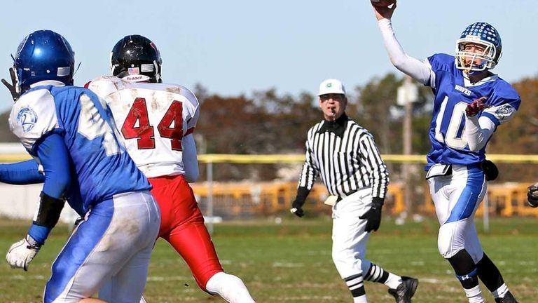 Riverhead's Ryan Bitzer throws the short pass to