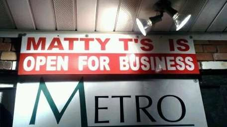 A sign on the storefront of Matty T's