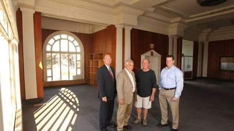 Inside Patchogue's Carnegie Library, built in 1905, are,