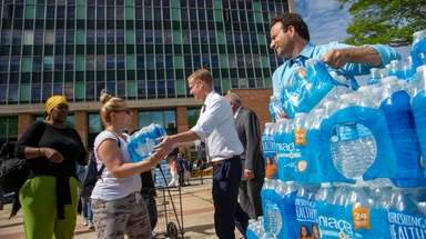 City officials hand out cases of bottled water