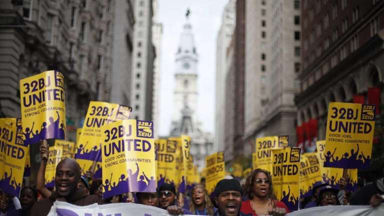 Members of Service Employees International Union march from