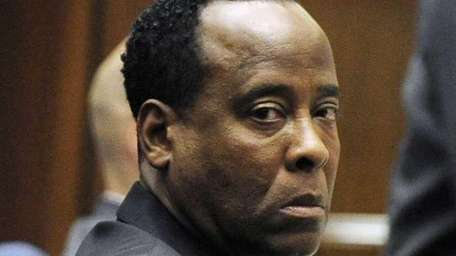 Dr. Conrad Murray listens to testimony by Dr.