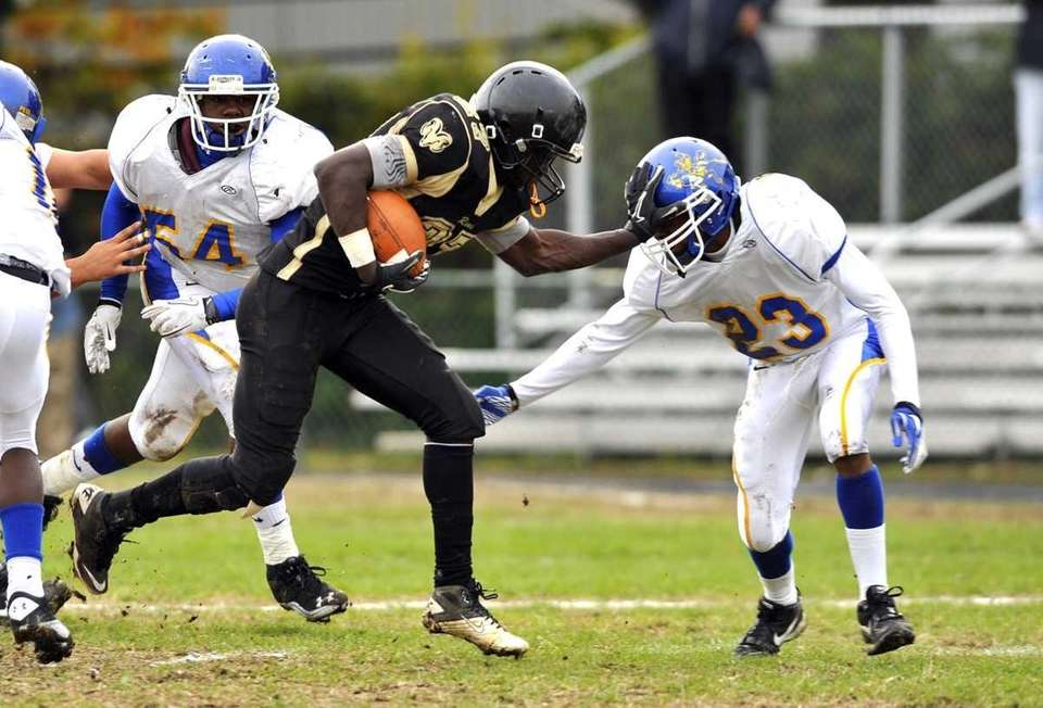 West Hempstead's Justin Boatwright pushes away Roosevelt's Jared