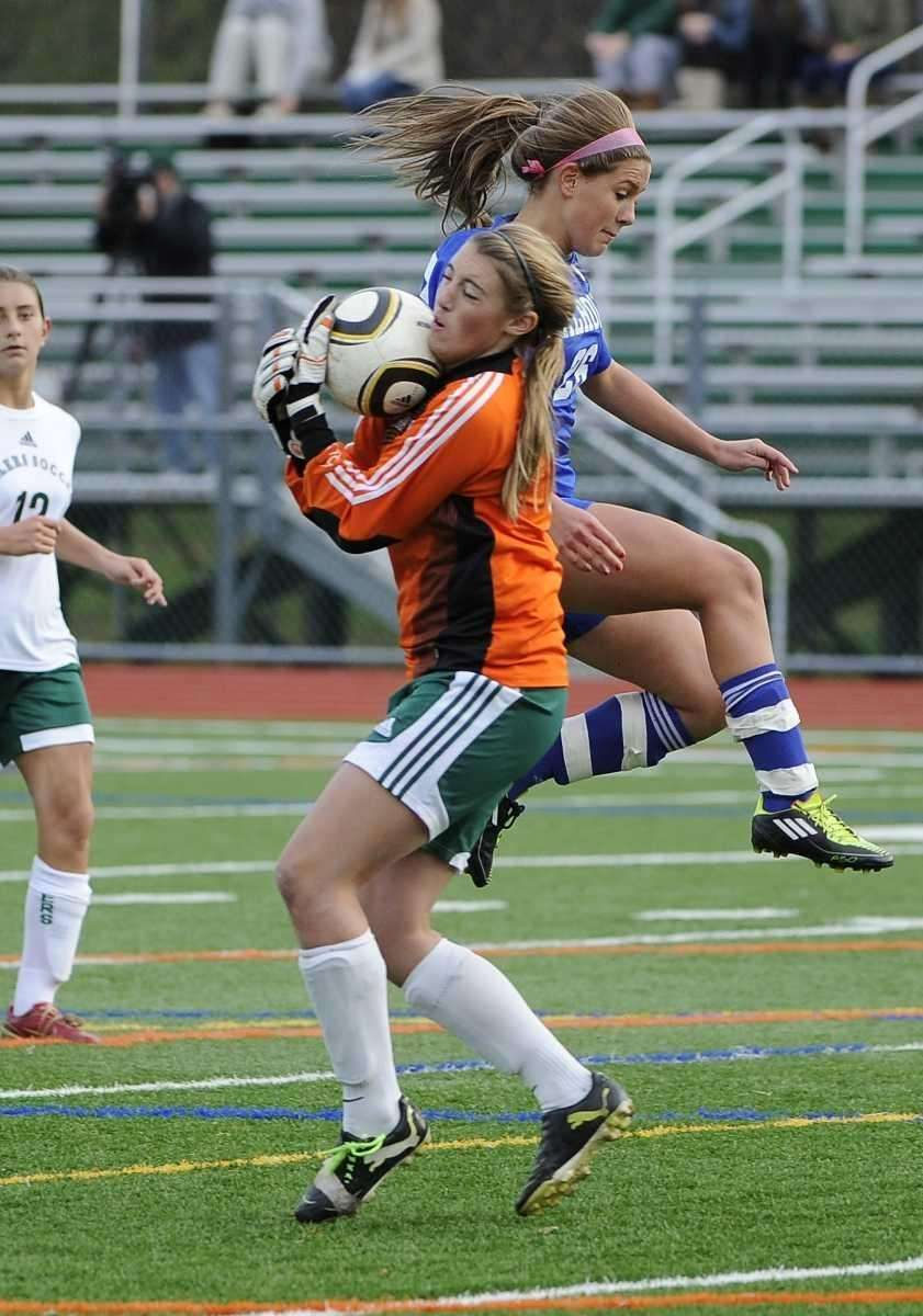 Farmingdale goalkeeper Kaitlin Gaghan saves a shot on
