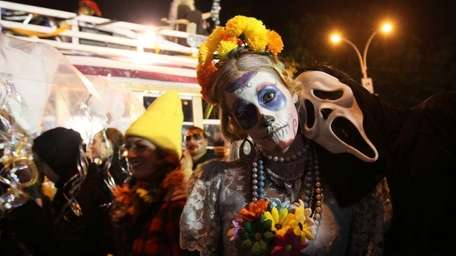Costumed participants in the Village Halloween Parade make