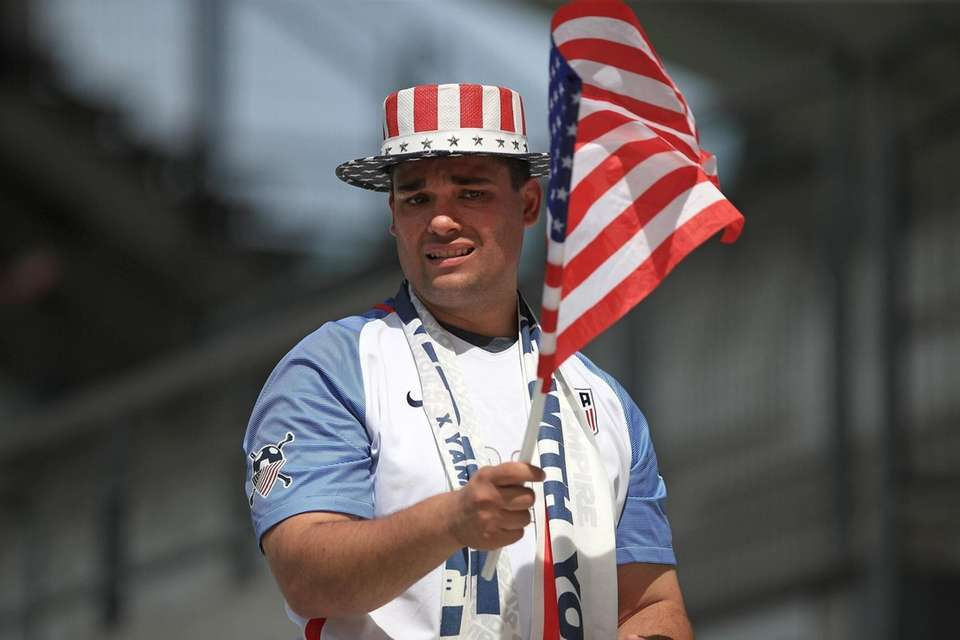 A USA fan shows their support before a