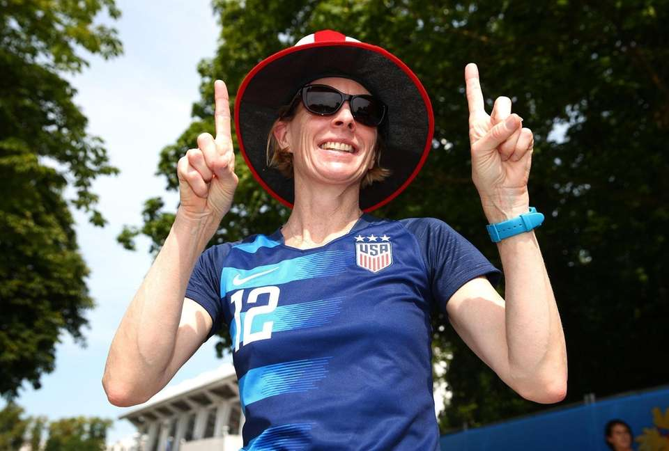 A USA fan poses for a photo outside