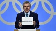 International Olympic Committee president Thomas Bach shows the