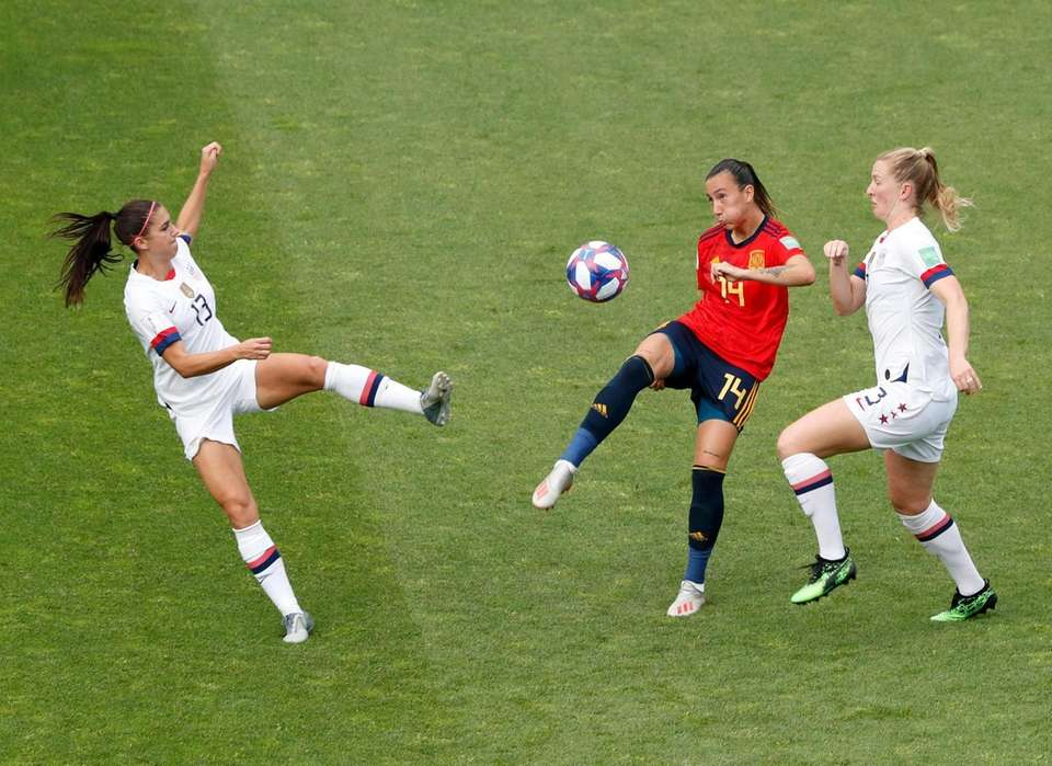Spain's Virginia Torrecilla, center, duels for the ball