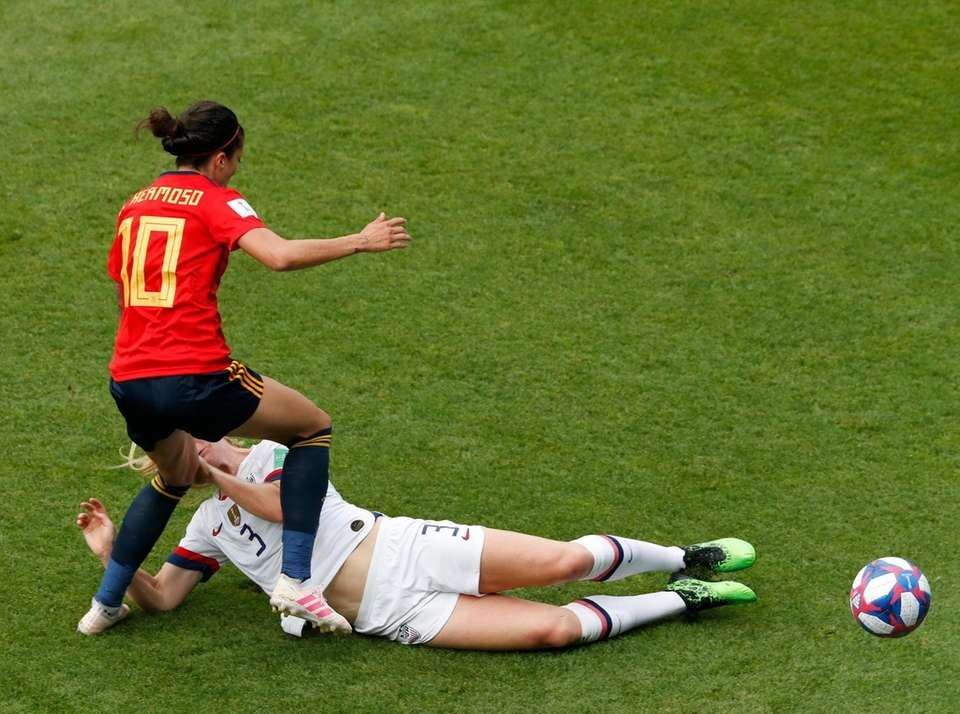 Spain's Jennifer Hermoso, left, duels for the ball