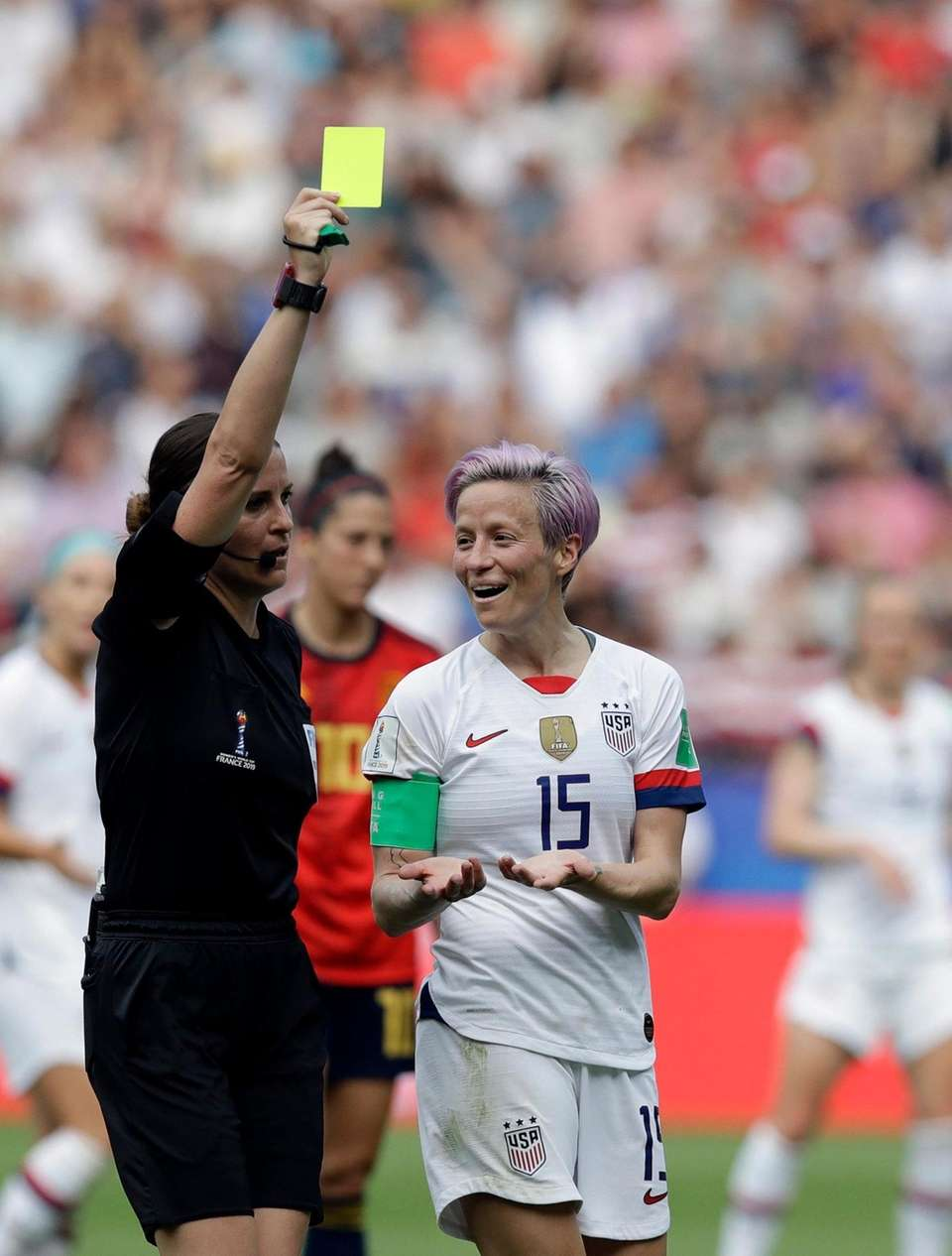 Referee Katalin Kulcsar of Hungary, left, shows the