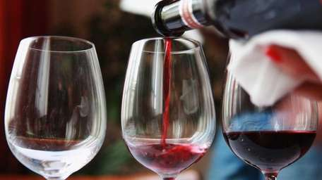 A selection of red wines is prepared for