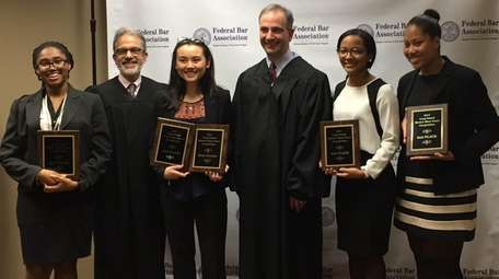 Magistrate Judge Gary R. Brown, second from left,