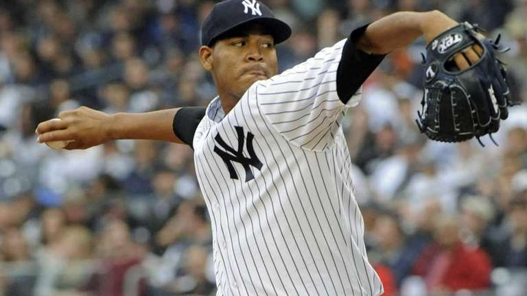 Yankees pitcher Ivan Nova delivers the ball to