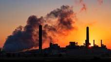 The Dave Johnson coal-fired power plant is silhouetted