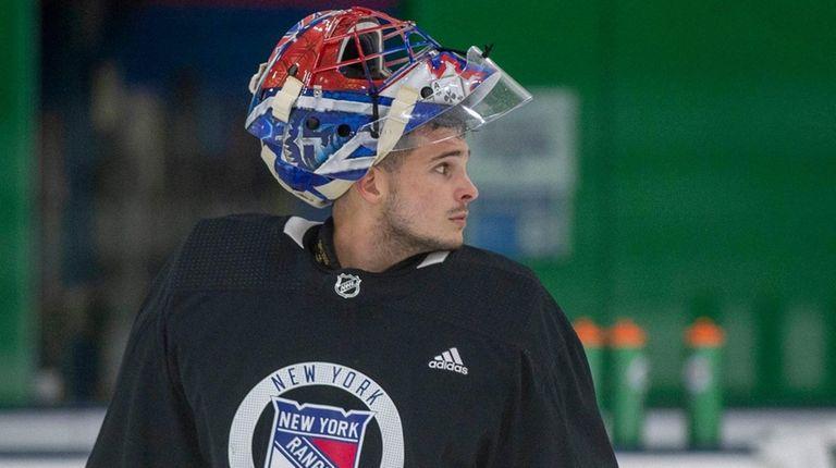 Rangers goalie #31 Igor Shesterkin looks on during