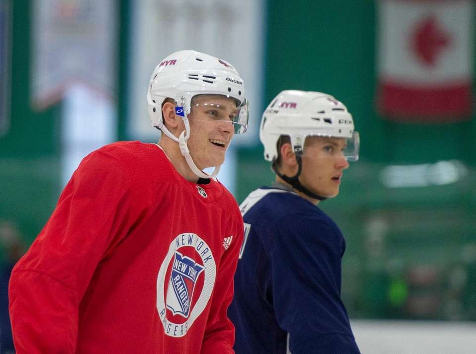 New York Rangers #45 Kaapo Kakko smiling. New