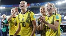 Swedish players celebrate at the end of the