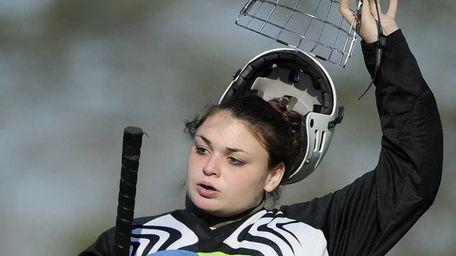 Bay Shore goalkeeper Courtney Alberto takes her helmet