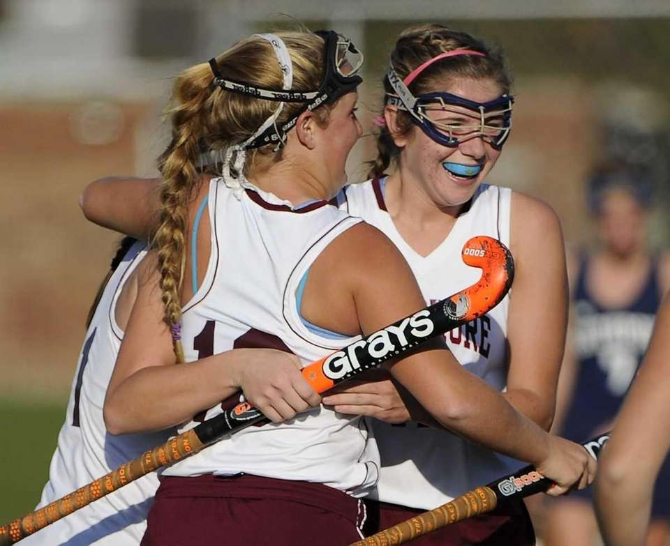 Bay Shore's Kyra Harney, left, and Erin Corcoran,