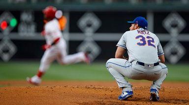 Mets starting pitcher Steven Matz, right, reacts after