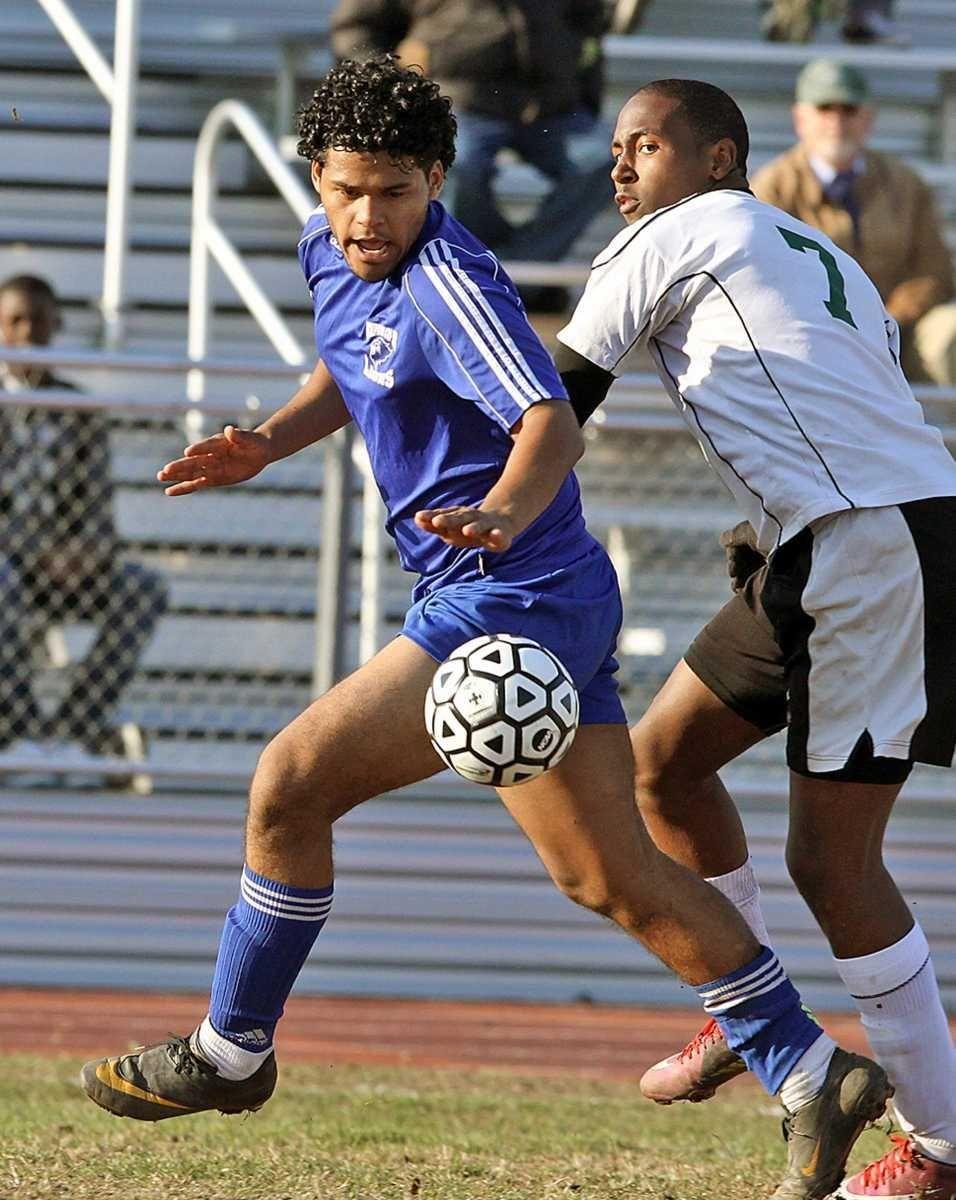 Hempstead's Joni Almendarez keeps ball in front during