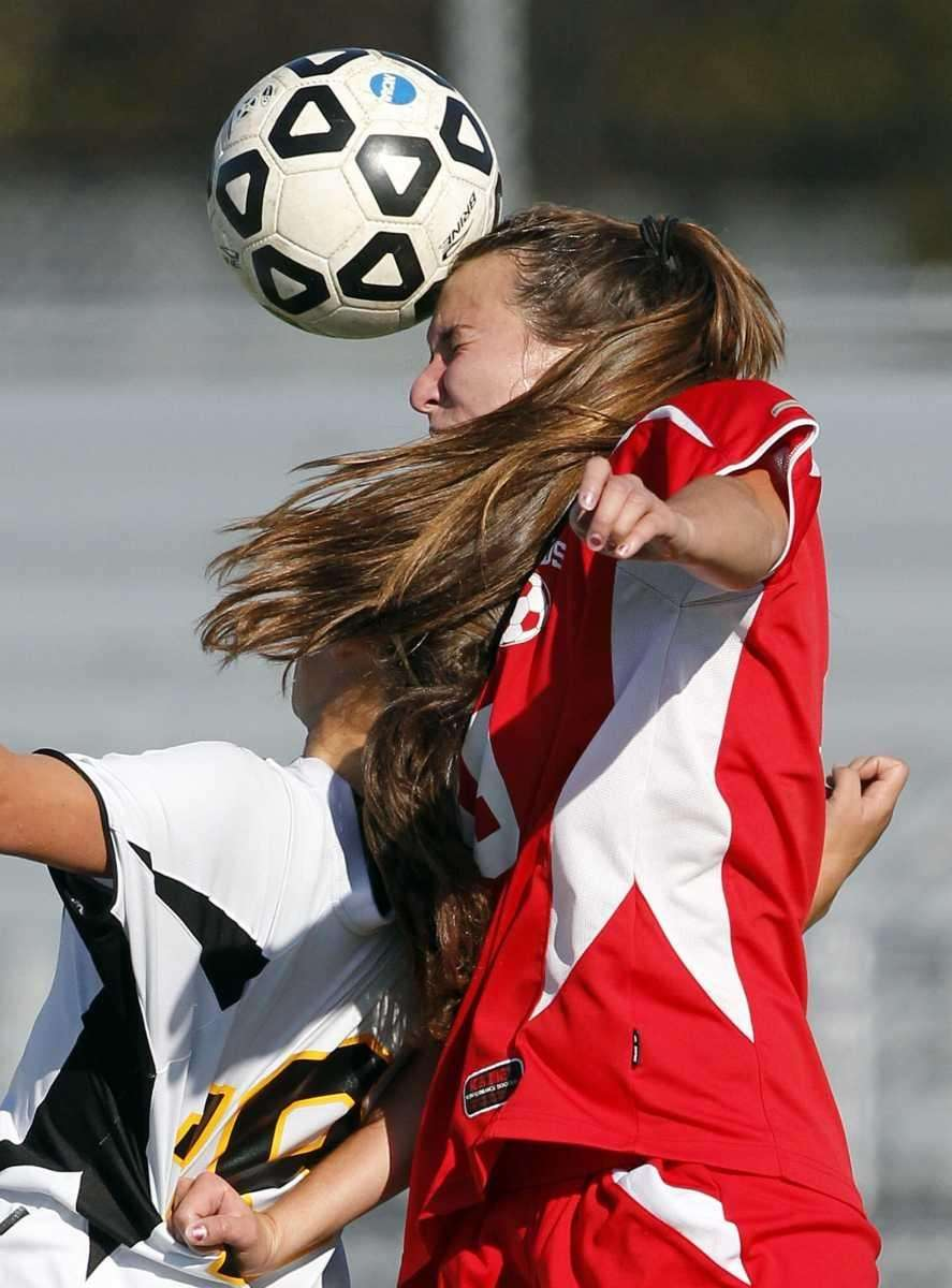 Connetquot's Kristen McKasty (19) with the header over